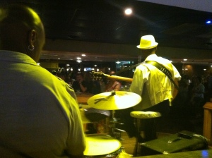 A drummers eye view of the world at 50 Yard Line with a seven man band and a sequined, 60+ plus set of swing dancers that were all out hitting it on the dance floor. The lady lead singer took a song break or two to bus some tables - pretty cool joint.